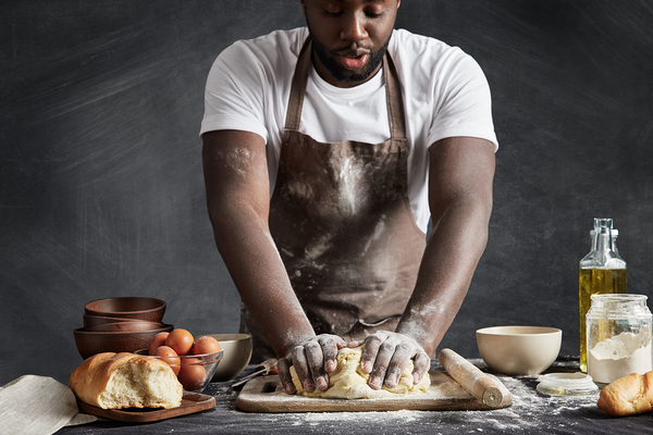 Baker kneading dough.