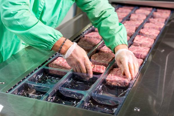 Working packaging meat.