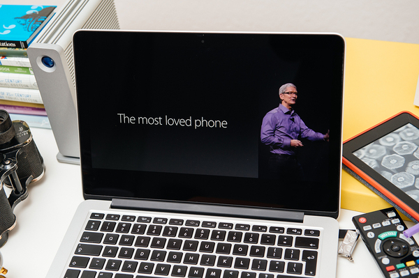 Laptop computer with Tim Cook of Apple on the display.