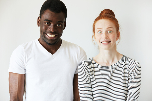 Man and woman with a look of surprise on their faces.
