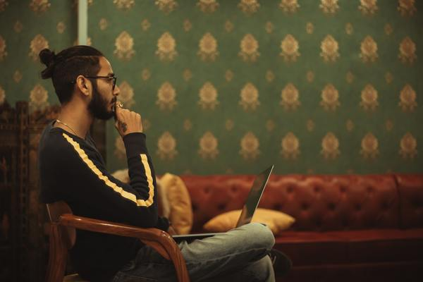 Man sitting with laptop.