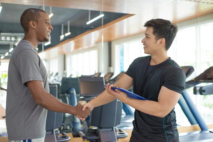 Hand shake at a gym.