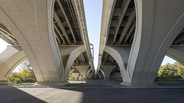 Underneath a bridge.