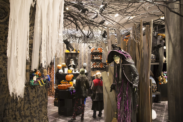 Halloween scene with a witch mannequin.