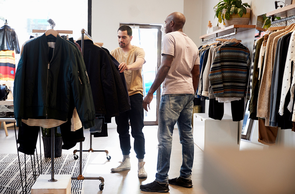 Two men shopping for clothing.