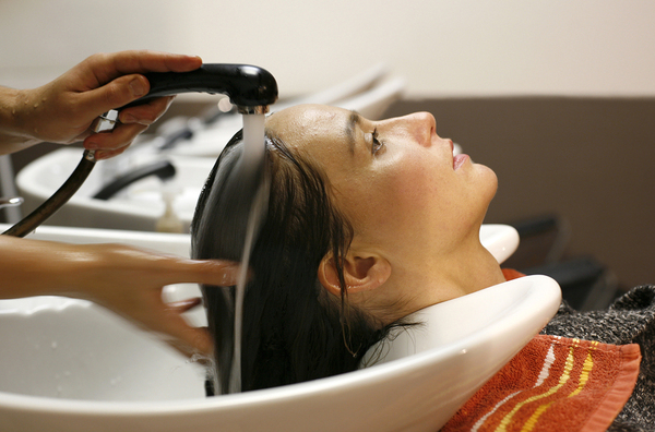 Woman having her hair washed in a beauty salon.