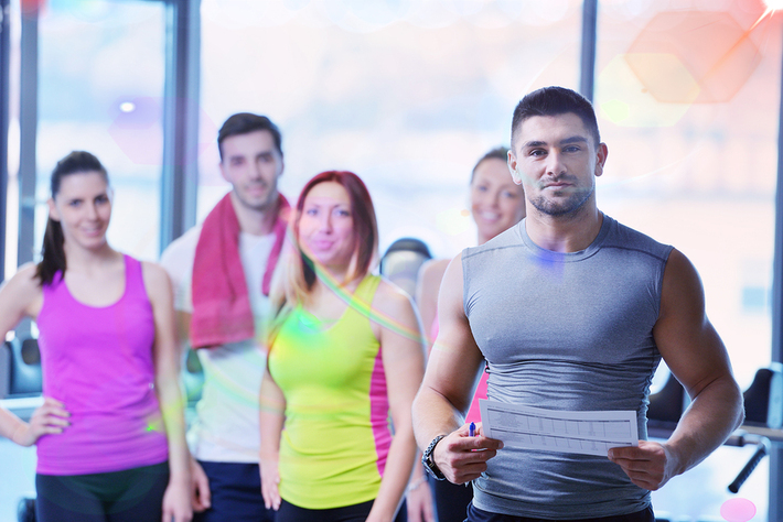Group of people in fitness clothing smiling.